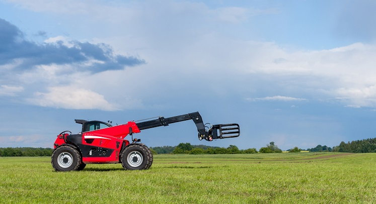 Red telescopic handler in the Lithuanian fields